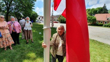 New flag poles and a shed in the church park