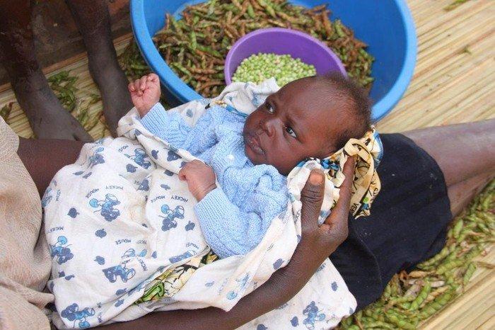 Billeder af børn med strikketrøjer på