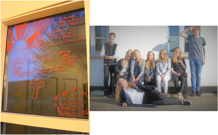 Tegninger på vindue og smilende teenager foran væg