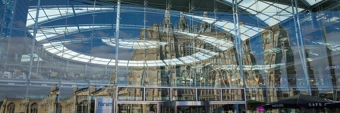 Photo of the church reflected in the glass of The Forum