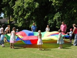 Children and Adults playing Parachute Games