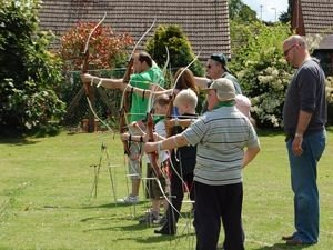 Scout Leaders leading an Archery Class
