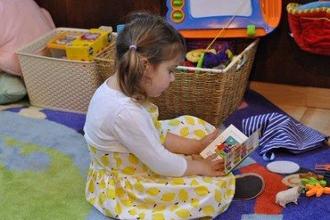 Photo of girl reading in our children's corner