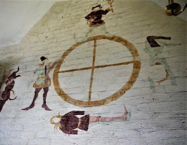 """Tårnet, nordvæggen: """"Livshjulet"""". Til venstre begynder kampen om en sjæl – se næste illustration."""