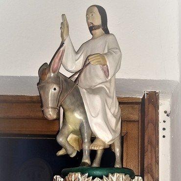 Jesus reitet auf einem Esel