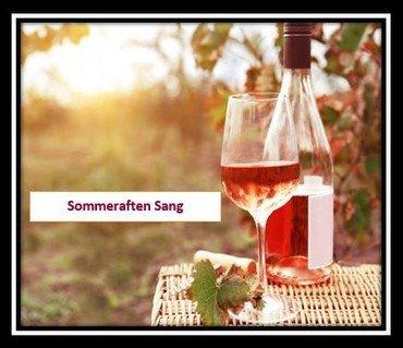 Billede af rose vin på picnickurv med solen i baggrunden